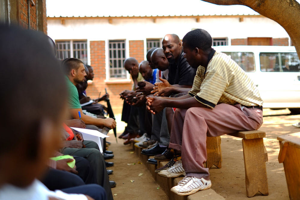 leaders meeting outside the church